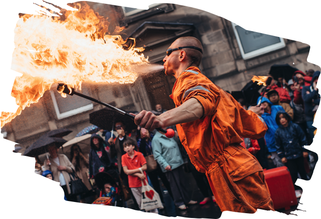 Street performer with fire